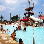 Families play together in waterpark pool
