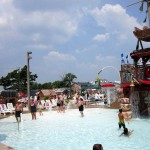 Visitors swimming in waterpark pool