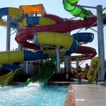 Father and daughter prepare to climb the waterslide