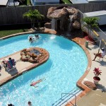 Visitors relax poolside and swim at Fenwick Island waterpark pool