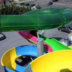 View of the green tube of waterslide from top of waterslide