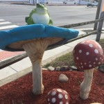 Decor of blue mushroom with frog sitting atop