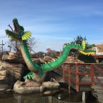 Double headed green dragon decor at mini golf course