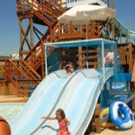 Girl slides down waterslide sliding board in OC