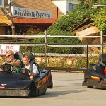 Mother and son race young boy in Ocean City go-karts