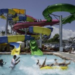 Father and son make a big splash from waterslide