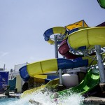 Visitor makes a big splash coming out of waterslide at waterpark