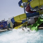 Man splashes into water from waterslide