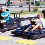 Older man and young woman ready to race go karts in Fenwick Island