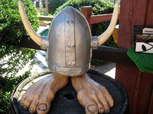 Troll feet wearing viking hat decor on mini golf course