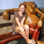 Girl sitting on bench with troll decor in Fenwick Island
